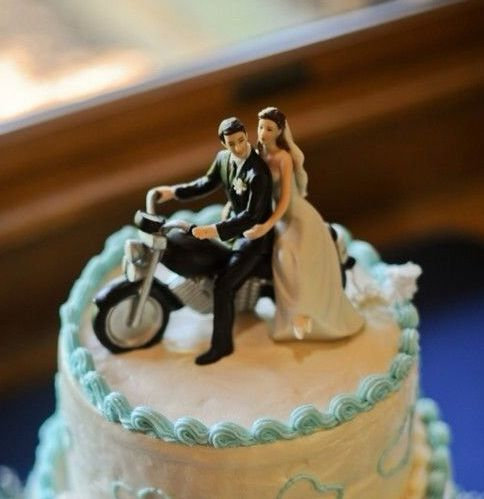 LOVE!!!! Another fantastic shot of one our cake toppers! Get your very own Motorcycle Get Away Couple Wedding Cake Topper here: http://www.weddingstar.com/product/motorcycle-get-away-wedding-couple-figurine