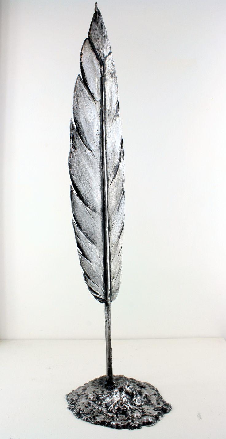 Large Aluminium Parihaka Feather, 1 meter high ..Patinated Aluminium .. Brett Rangitaawa, 2014