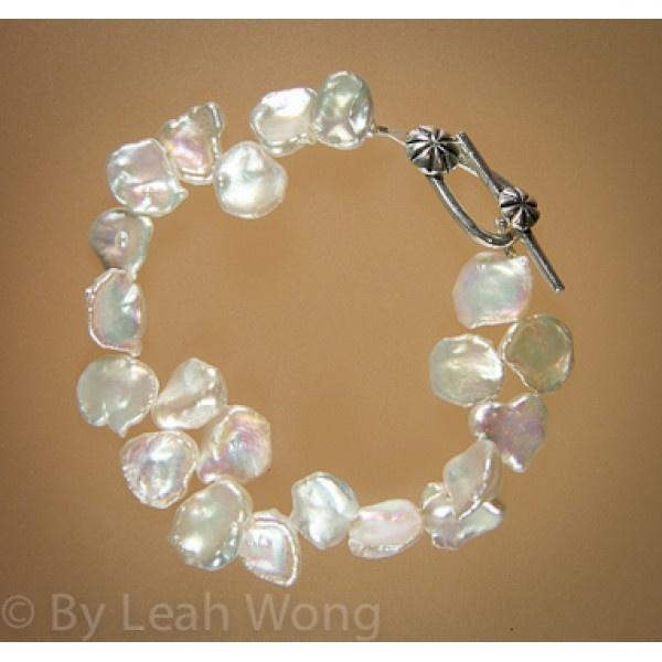 Unique bracelet with pedal pearls. $49.00