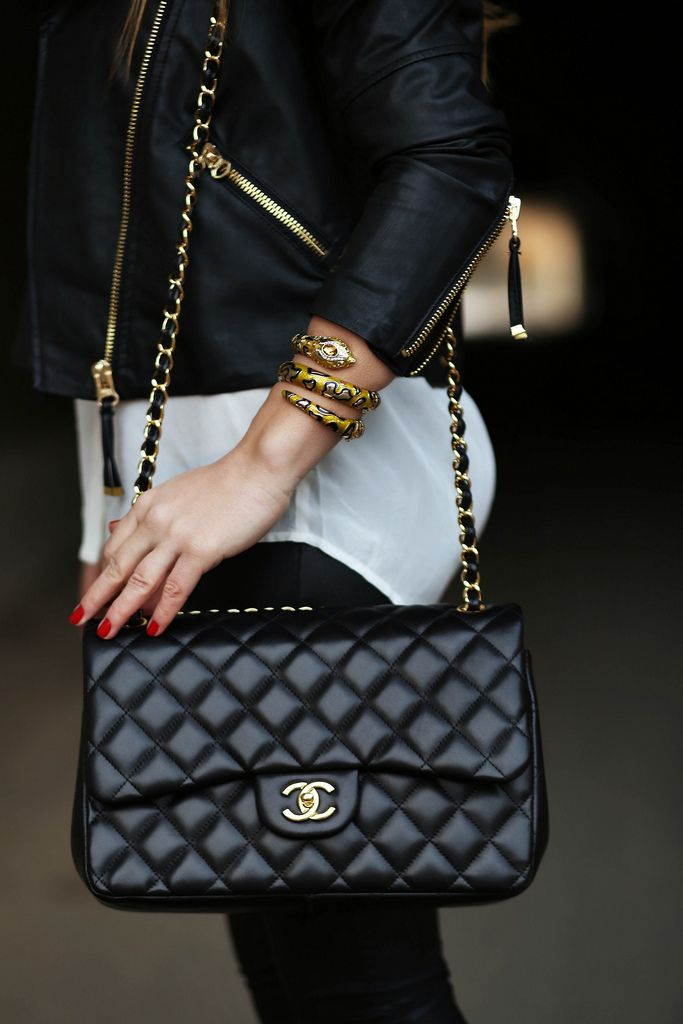 Classic look = black leather jacket with gold zippers and black flap chanel with gold hardware