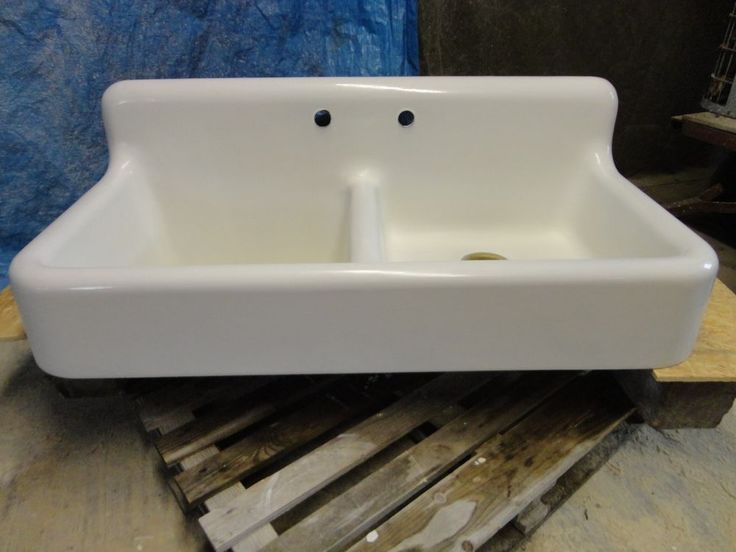antique double cast iron farmhouse sink with high back