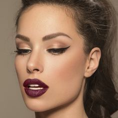Dark red lip ('not plum like this), cat eye and natural bronzed/golden lid without a smokey eye effect. Brightened inner corners of eyes