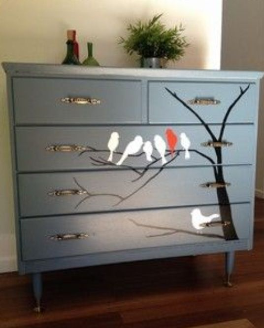 Painted chest of drawers with tree and bird stencil