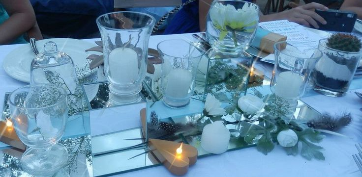 Tables were simple, romantic , bush themed too.