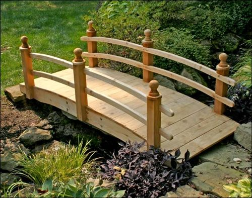 This quality double-rail Japanese garden wooden bridge features reliable construction and will add a unique look to your Japanese style garden or koi pond.
