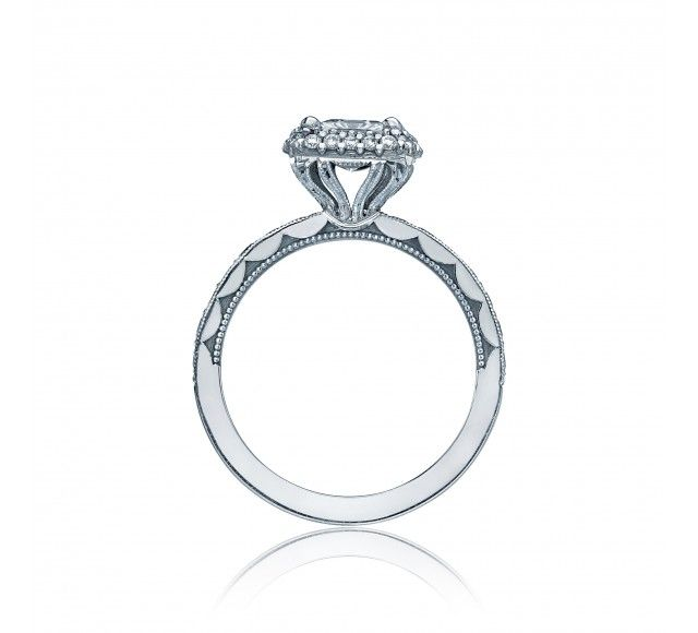 Double+up+the+bloom+for+double+sparkle!++A+princess+center+glows+with+a+double+diamond+bloom+and+round+diamonds+halfway+along+the+band.+Clean+crescent+engraving+and+miligrain+details+add+interest+to+the+profile+of+this+engagement+ring.