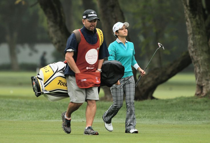 Ai Miyazato and Mick Seaborn Photos Photos - Ai Miyazato of Japan walks with her caddie Mick Seaborn on the first hole during the final round of the Lorena Ochoa Invitational Presented by Banamex at the Guadalajara Country Club on November 17, 2013 in Guadalajara, Mexico. Lorena Ochoa Invitational Presented by Banamex and Jalisco - Final Round