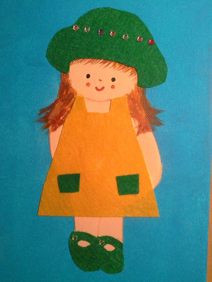 Niña con sombrero verde