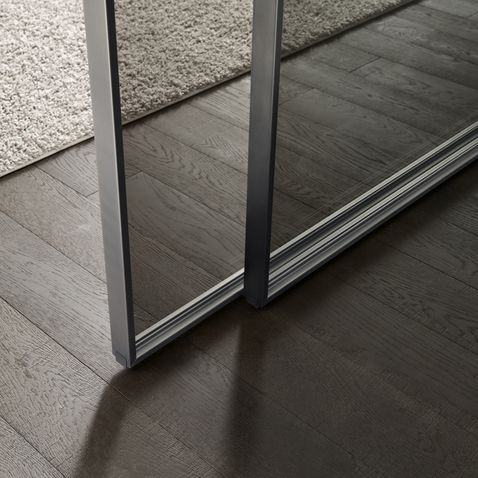 Door detail by Rimadesio. Structure in brushed lead and grey transparent glass.