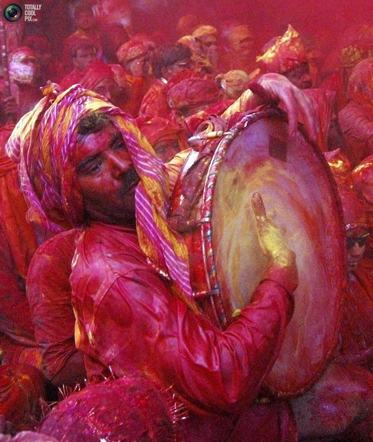 A man plays a drum as he celebrates Lathmar Holi, also known as the Festival of Colours, at Barsana in the northern Indian state of Uttar Pradesh