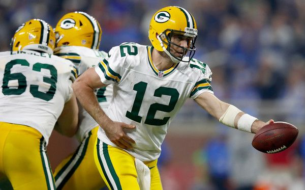 Aaron Rodgers Photos Photos - Quarterback Aaron Rodgers #12 of the Green Bay Packers looks to hand off the football against the Detroit Lions during second half action  at Ford Field on January 1, 2017 in Detroit, Michigan - Green Bay Packers v Detroit Lions