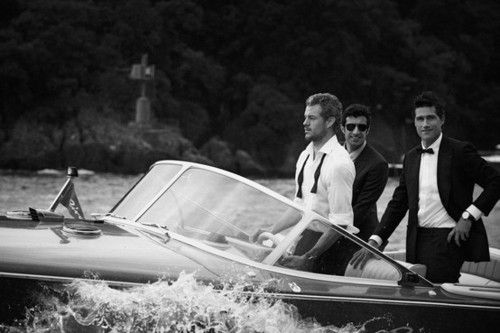 Suits and sunglasses in a Riva,...does it gets any better than this?!