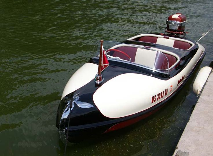 Falls Flyer, an awesome antique boat to complement a large classic wooden boat