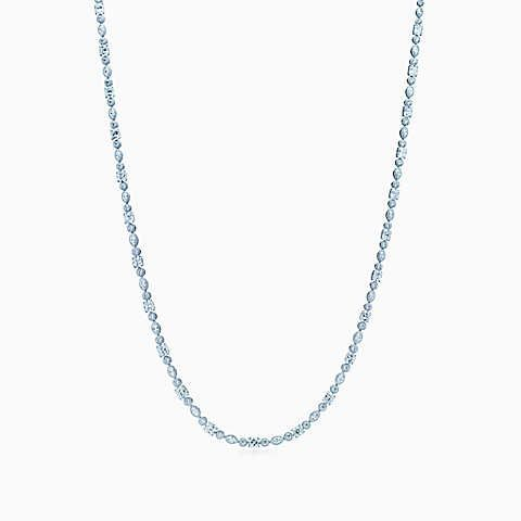 Lucida® diamond opera necklace in platinum with marquise and round diamonds.