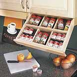 This is perfect! It wont take up cabineit space!! Drop-Down Trays — In this kitchen, we've mounted four storage trays in that under-cabinet space. These trays pull open like regular drawers, but then they drop down at an angle and lock in place, putting spices, knives, or your favorite recipe right at hand.