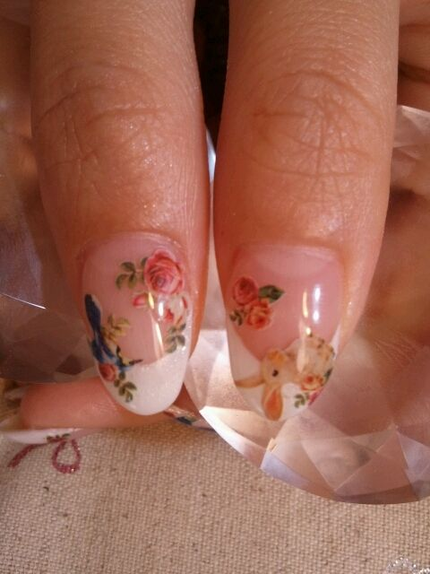 bunnies and floral nail art. Cute, but im a square nail kinda gal!