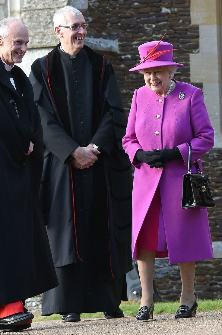 After wrapping up in a brown fur coat Christmas morning, the Queen stepped out in a festive fuchsia coat over a raspberry dress .