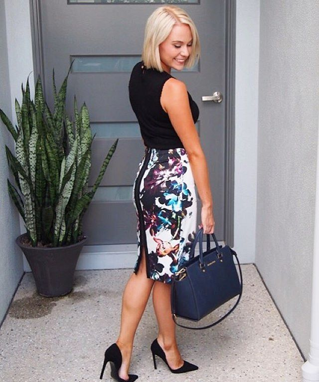 Black top + floral pencil skirt + navy bag + heels