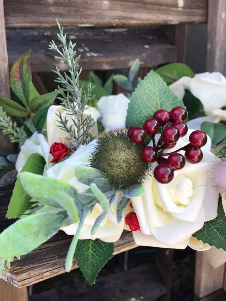 Rustic wedding halos with artificial flowers and greenery