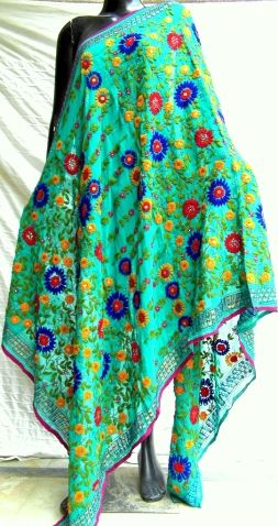 This gorgeous phulkari work georgette dupatta is in a unique shade of green, with heavy embroidery. It has been hand embroidered in a vibrant colored floral pattern, with wool thread and sequins - See more at: http://giftpiper.com/Handembroidered-Phulkari-Work-Georgette-Dupatta-Green-id-278821.html#sthash.PEIjz7rA.dpuf