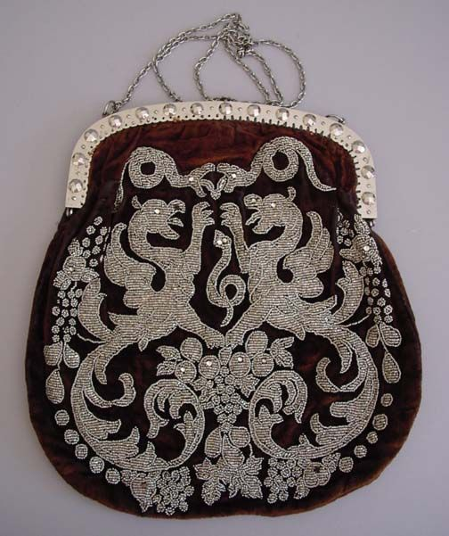 VICTORIAN brown velvet purse with tiny cut steel beads in a regal griffon and snakes motif, faceted steel brads on frame.