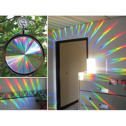 The Rainbow Window Holographic Prism hangs on your room's window and during sunlight it spreads reds, oranges, yellows, greens, blues and violets in your entire room.
