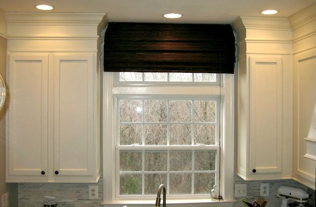 love how the mouldings make the soffit part of the cabinets