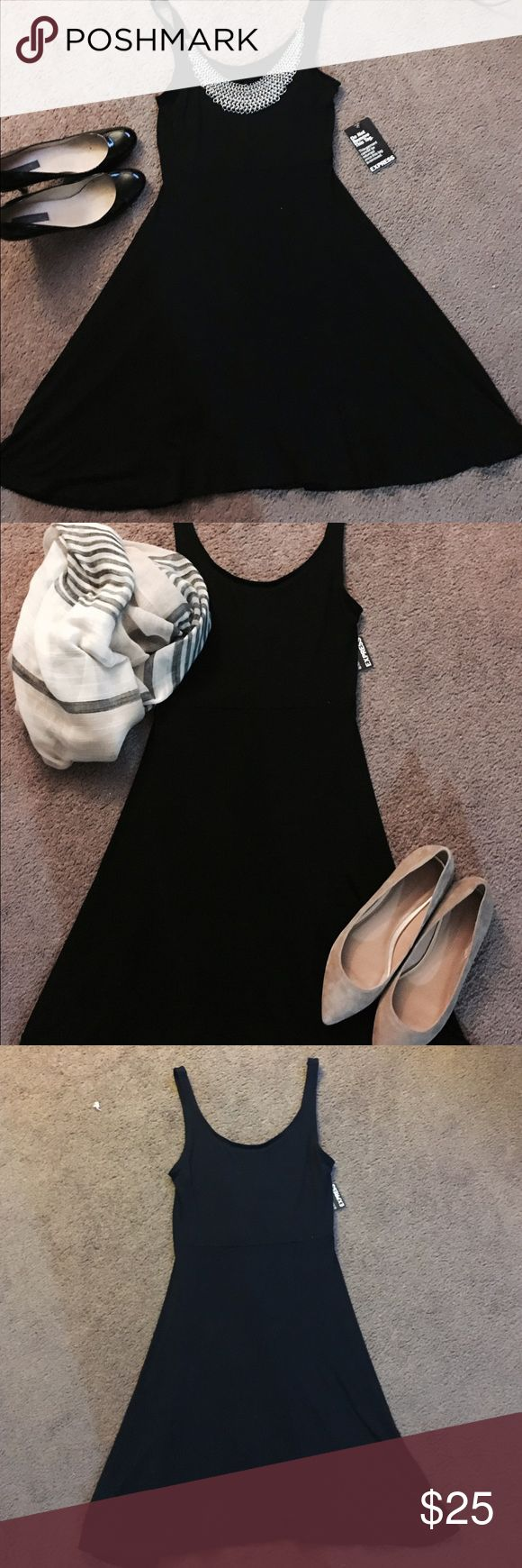 Lil Black Dress! New Simple and perfect Rayon and Spandex dress! Never worn, fits amazing and easy, very comfortable and so versatile- dress up or down, layer with leggings! It really is the perfect everyday black dress! Nwt- hits right above knee Express Dresses Midi