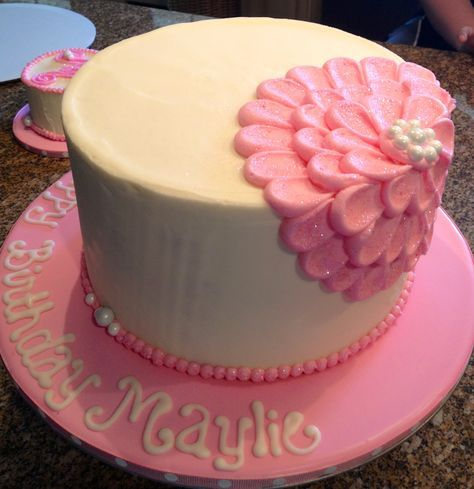 birthday cake- beautiful yellow and pink cake with pearls circling the base and a flower on the side of the cake.