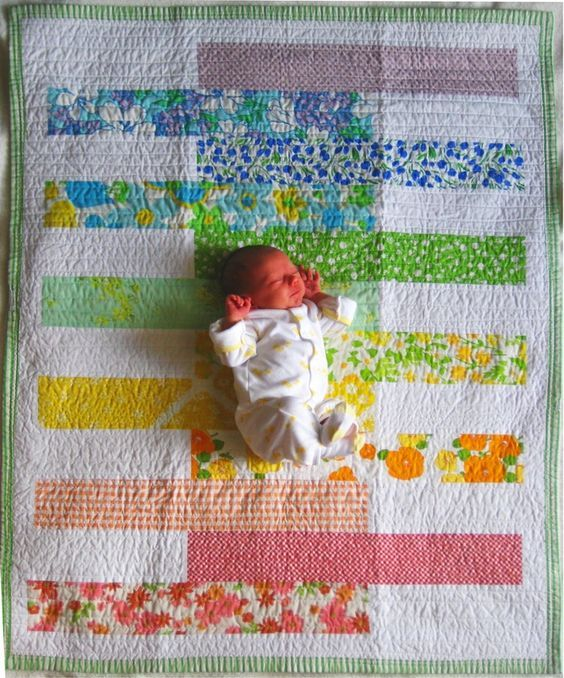 This is always how I see in my mind a baby quilt that I am working on, with the sweet baby centered in the middle. little miss claire's rainbow quilt... ♥