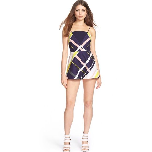 """Finders Keepers the Label Romper A bold, graphic pattern is splashed across a playful romper defined by a faux-wrap bodice revealing a small cutout beneath the bandeau-like top. Tailored darts lend a clean, modern look to this leg-flaunting style. 29"""" length; 2 1/2"""" inseam; 30"""" leg opening Hidden back-zip closure. Spaghetti straps. Lined. Hand wash cold, line dry. By Finders Keepers the Label; Finders Keepers Dresses Mini"""