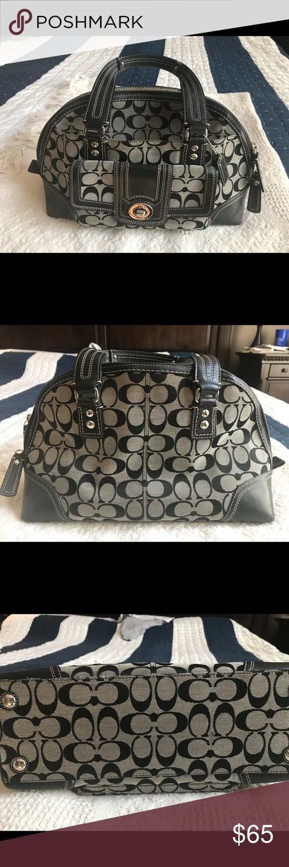 Authentic Signature Coach Purse Authentic Signature Coach Purse. In used but really good condition. There is a dime sized spot on the very bottom of the Purse as shown in photos. Handles are in good shape. No cracking. Inside is a little dusty from use but would easily wipe out. Color is black and gray. Coach Bags Shoulder Bags