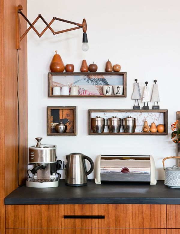 Kitchen details. Wall light – a vintage Danish find. Box shelves by Bonnie & Neil. Retro Pears and apples collected over time, pottery figures bought on a trip to Iceland. Retro stainless steel canisters from One Small Room. Danish buffet from Mid Century Modern.Teak veneer used on all kitchen cabinetry. Photo -Jacqui Way.