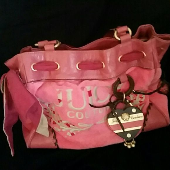 Juicy Couture Handbag Pretty coral terrycloth bag with brown accents and brushed gold hardware. Pretty ribbon at top of bag. Overall in very good condition. This item is a Re-Posh. Nice details! Girly girl!  Juicy Couture Bags Shoulder Bags