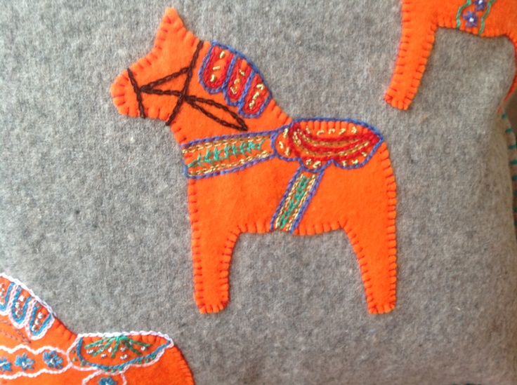 Handmade Dala Horse cushions using vintage blankets, threads and wool.