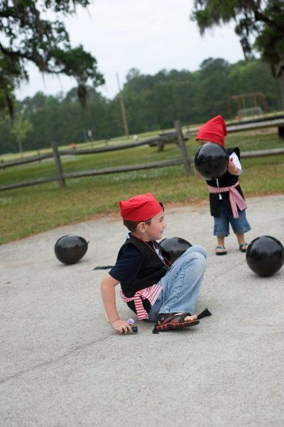 """popping """"cannon balls"""" with prizes...put a pirate eye patch in each balloon...and have kids pop..in order for kids to complete their pirate transformation"""