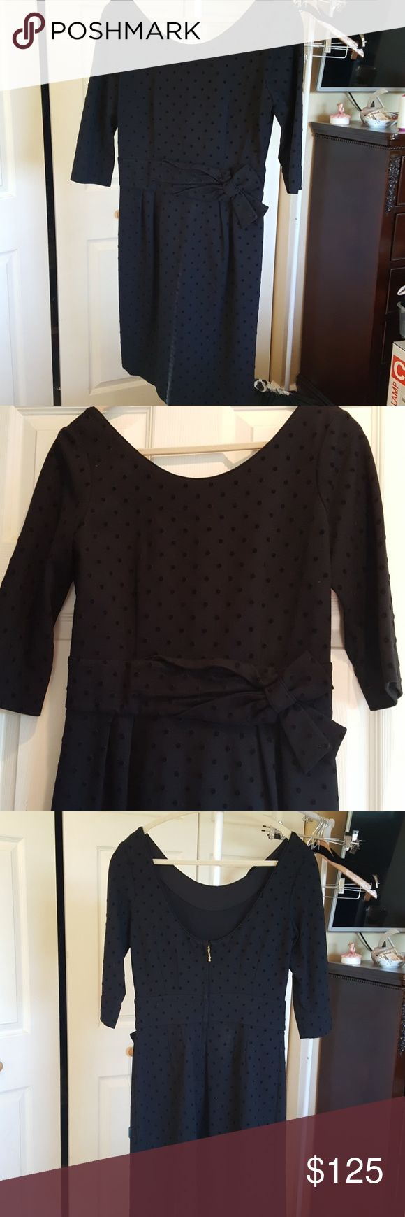 Kate Spade polka dotted elegant cocktail dress. Wonderfully soft fabric..3/4 sleeves 18 from shoulder to cuff.  Cute unusual zipper detailing..stretch to fabric. Measures 15 across waist..about 18 across bust..shoulder to hem 38..cute bow at front.  Great for upcoming holidays!! kate spade Dresses