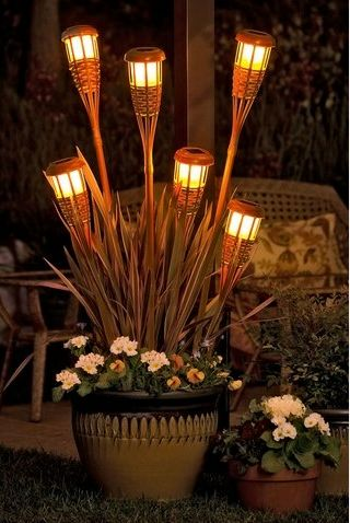 tiki torch planter is such a great way to bring some light to an area, kill the mosquitos & provide some beauty along the way...