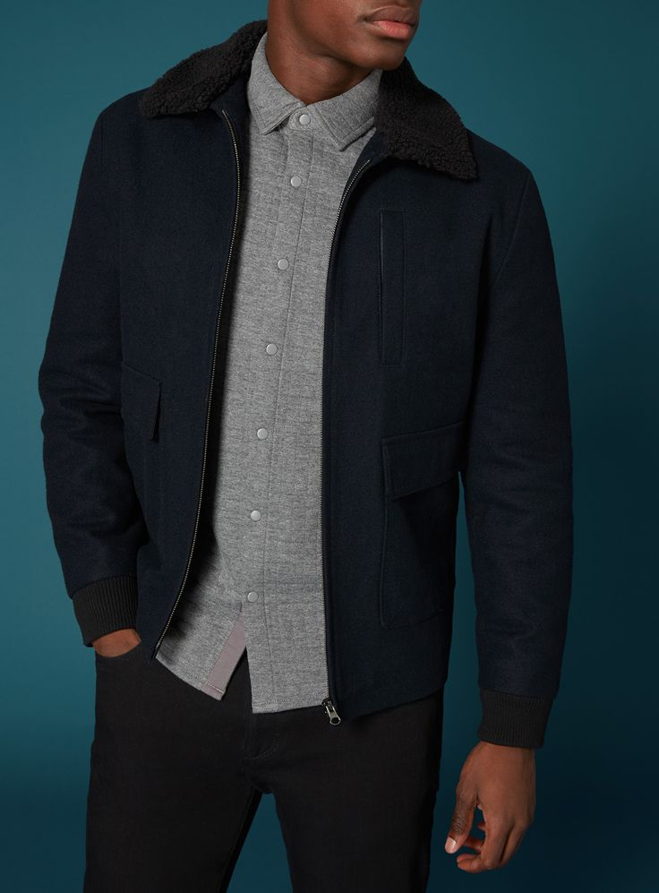 A classically styled jacket with modern detailing. The wool collar lends a trendy touch, also punctuating it's ruggedly smart-casual aesthetic. Pair with denim, chelsea boots and a white tee for a stylish everyday look. Navy wool borg collar jacket Wool collar Front pockets Chest pocket Model's height is 6'2'' Model wears a size M