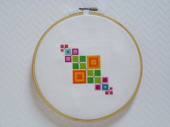 A modern cross stitch pattern designed to be simple and relaxing to stitch. It measures 49 stitches wide by 49 stitches high giving it a