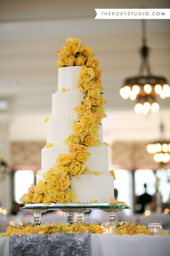 Photography by Samantha McGranahan, The Roxy Studio. Wedding photography, wedding cake, white and yellow cake, yellow roses, yellow wedding cake, St. Mary of the Woods wedding, tiered wedding cake, purple and yellow wedding