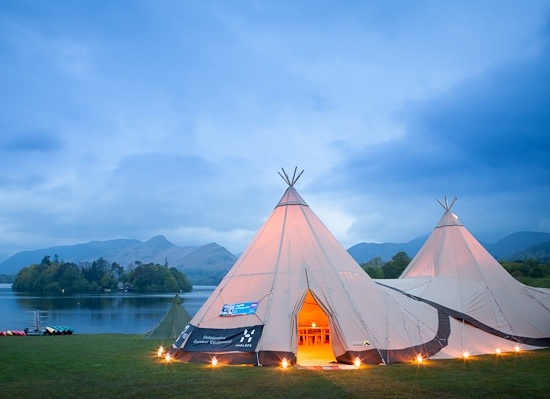 Lakeside tipis!  Keswick Mountain Festival, with Derwentwater in the background.  Photo: Fjell Event Tipis  #tentipi #festival #tipis
