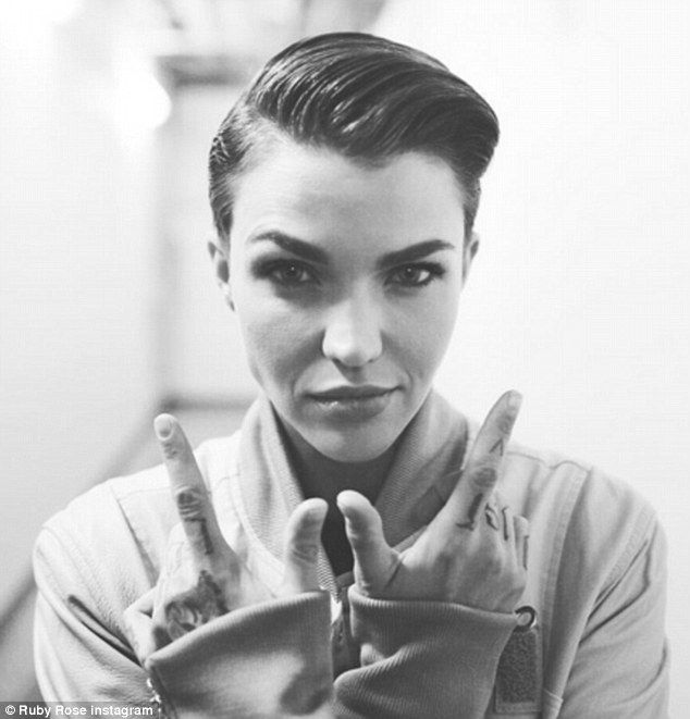 Travelling with style: Ruby Rose  slicked her short dark locks into a comb over on Monday ...