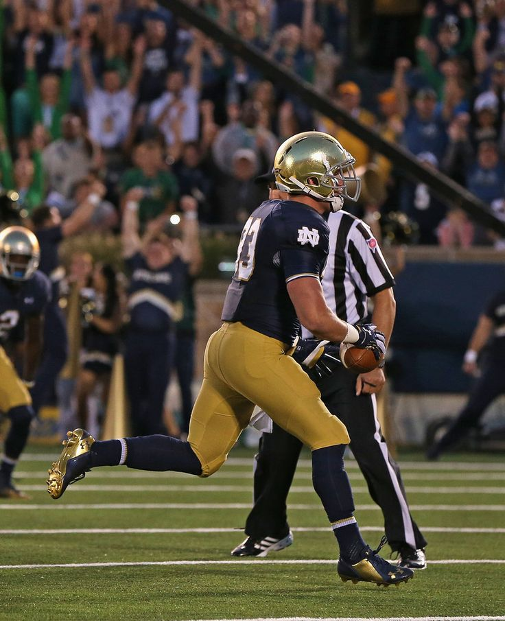Cam McDaniel #33 of the Notre Dame Fighting Irish scores a touchdown in the first quarter against the Michigan Wolverines at Notre Dame Stadium on September 6, 2014 in South Bend, Indiana.