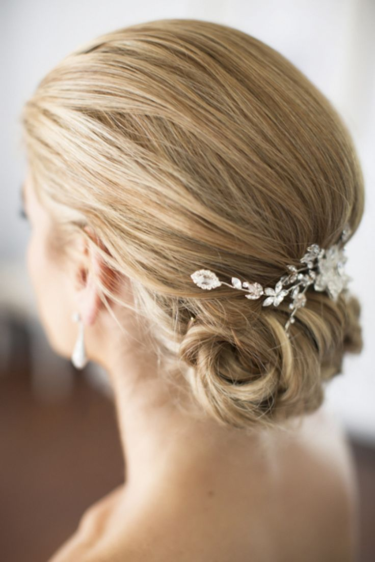 A sleek updo will never go out of style: http://www.stylemepretty.com/2015/08/25/classic-wedding-details-that-stand-the-test-of-time/