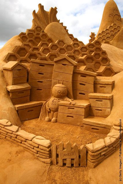 Melbourne, Australia - A sand sculpture entitled 'The Hive' carved by Kevin Crawford, Jim McCauley and Peter Redmond from Australia