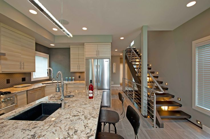 Modern Monday //  Loving the clean lines in this kitchen and stairway. The modern design created openness on a narrow building lot.