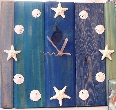 This is from a store but you could make your own using recycled wood, a clock kit and some beach treasures you found on vacation.