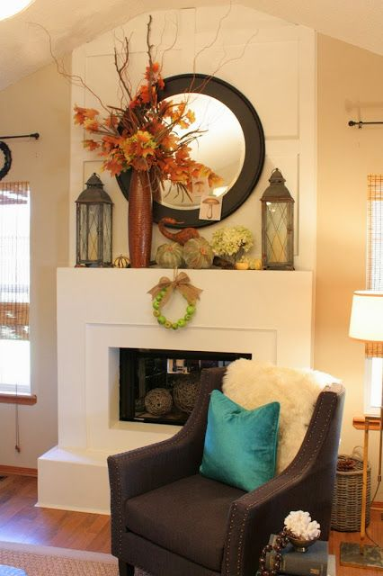 Mirror and lanterns above fireplace.