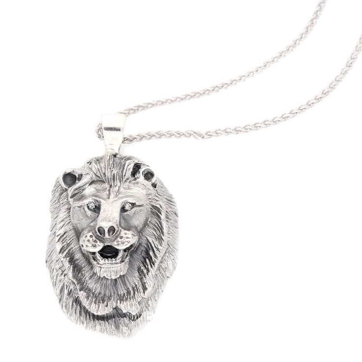 Silver Lion Pendant with Small Round DiamondEyes Equalling 0.03ct.    www.uwekoetter.com